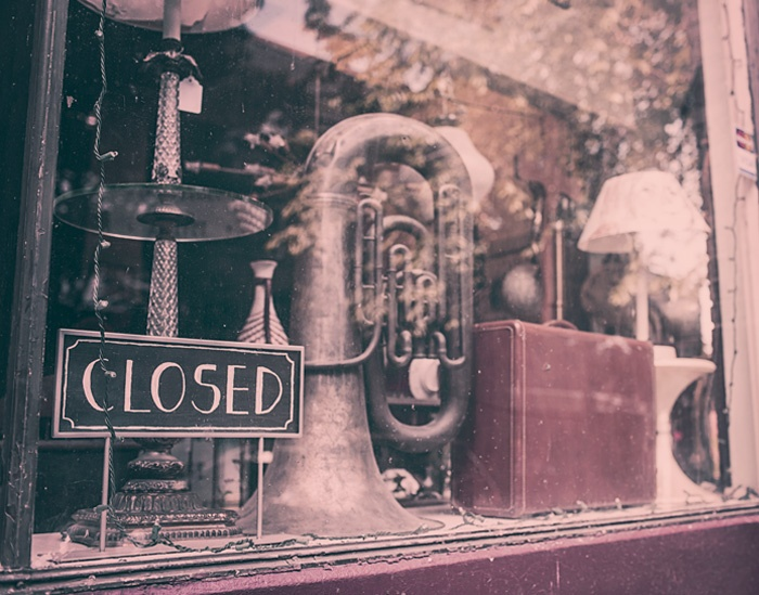 An image of a retail store window with a closed sign