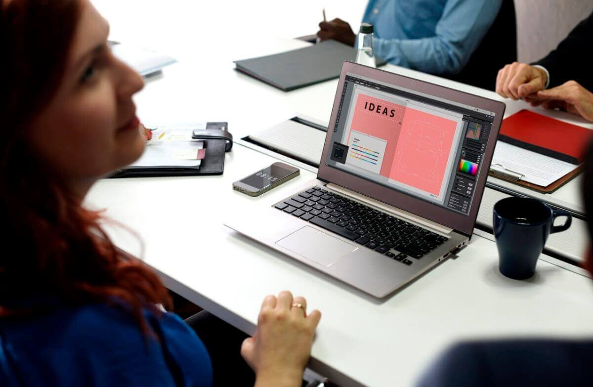 Woman sitting at a laptop computer that says ideas