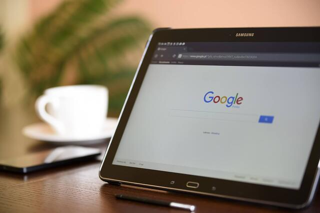 Image of a laptop displaying a Google search page