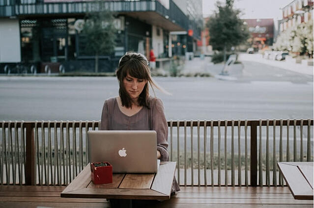 Woman using a laptop outside