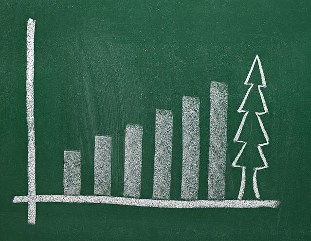 close up of chalkboard with finance business graph and christmas tree.jpeg