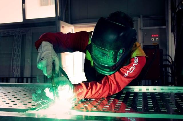 Welder working with aluminum