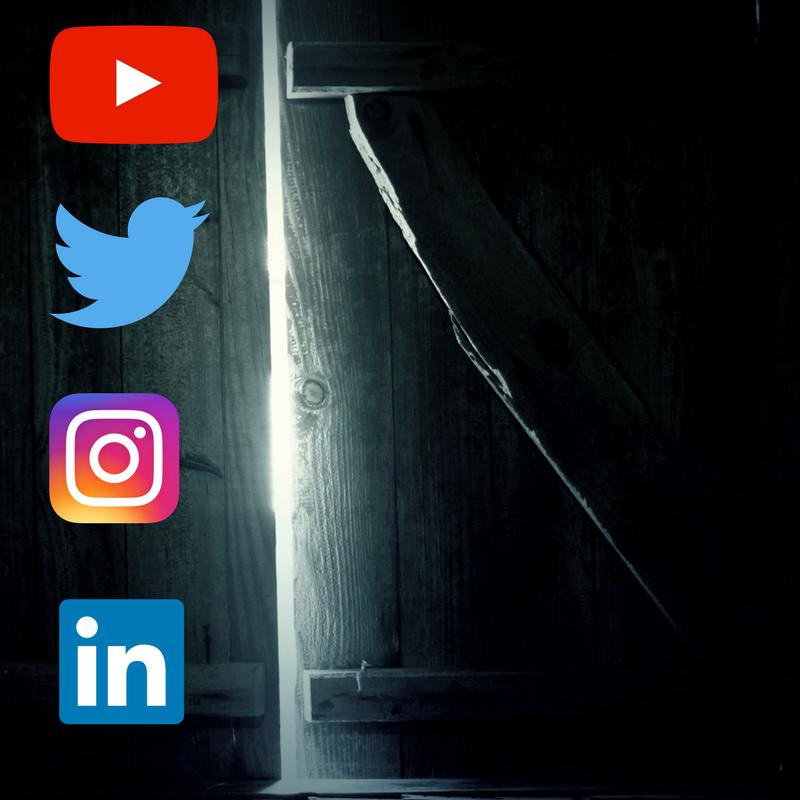 A dark room with social media logos