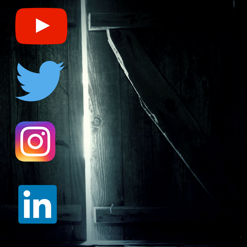 A dark room with social media logos